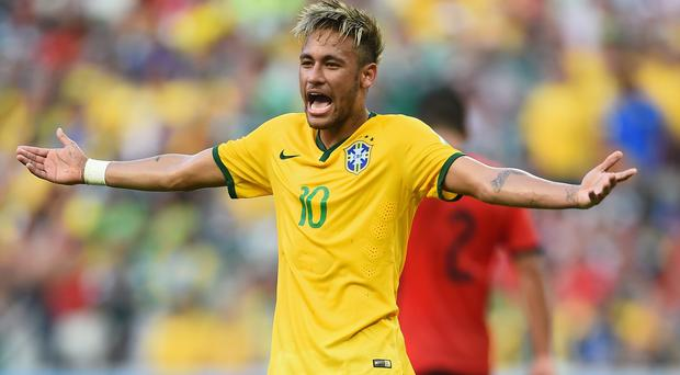 Neymar of Brazil reacts during the 2014 FIFA World Cup Brazil Group A match between Brazil and Mexico