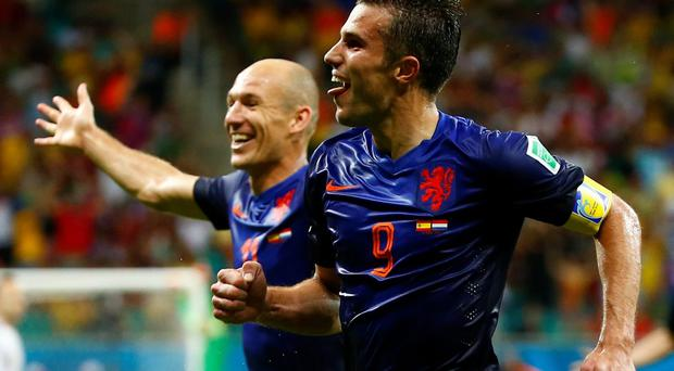 Robin van Persie celebrates with teammate Arjen Robben after scoring the team's fourth goal against Spain during their 2014 World Cup Group B soccer match at the Fonte Nova arena in Salvador. REUTERS/Tony Gentile