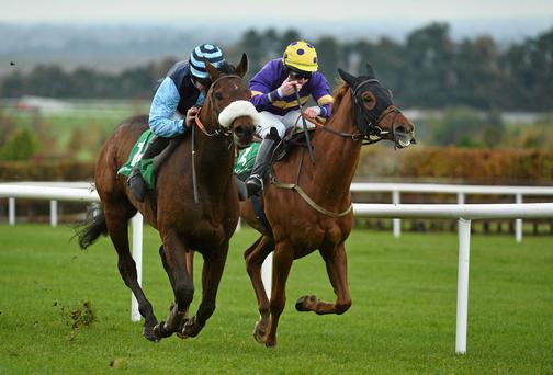 Big Generator, right, with Conor Walsh up races Spacious Sky, left, with Robbie Colgan up, towards the finishline on the way to winning the St Johann Ski Resort Tirol Austria Handicap Hurdle. Navan Racecourse, Navan, Co. Meath. Picture credit: Barry Cregg / SPORTSFILE