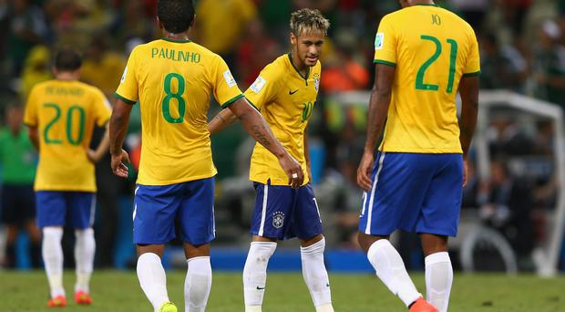 Neymar of Brazil reacts with teammate Paulinho after their 0-0 draw with Mexico during the 2014 FIFA World Cup Brazil Group A match between Brazil and Mexico at Castelao in Fortaleza, Brazil. Photo by Michael Steele/Getty Images