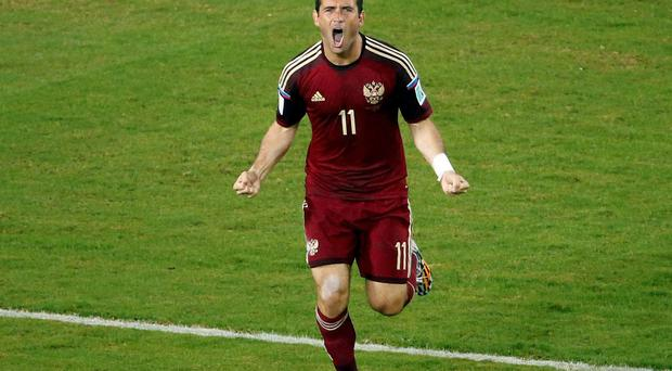 Russia's Alexander Kerzhakov celebrates after scoring the equaliser against South Korea at the Pantanal arena in Cuiaba. Reuters