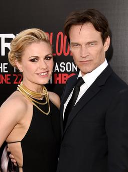 HOLLYWOOD, CA - JUNE 17: Actors Anna Paquin (L) and Stephen Moyer attend the premiere of HBO's