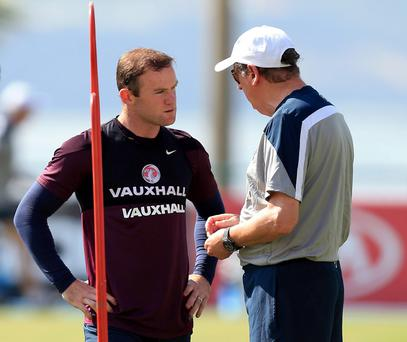 England manager Roy Hodgson with Wayne Rooney during a training session at the Urca Military Training Ground, Rio de Janeiro, Brazil