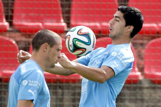 Uruguay's Luis Suarez trains with his team at Arena do Jacare Stadium in Sete Lagoas, Brazil