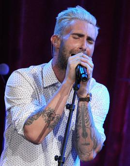 Singer-songwriter Adam Levine of Maroon 5 performs at the annual BMI Pop Awards at the Regent Beverly Wilshire Hotel on May 13, 2014 in Beverly Hills, California.
