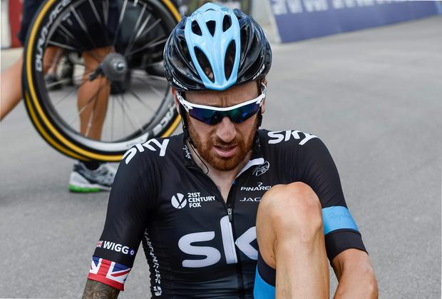 Team Sky's Bradley Wiggins was forced to pull out of the Tour de Suisse yesterday after sustaining injuries in a crash on stage four of the race. Photo: AP Photo/Keystone/Jean-Christophe Bott