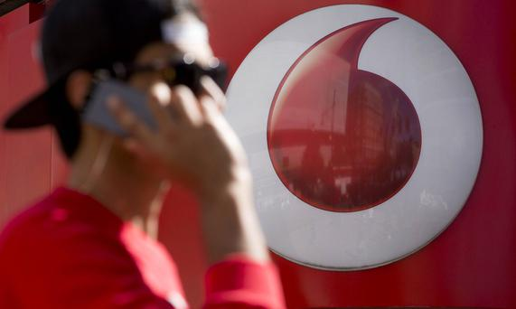 Vodafone lost 101,000 mobile phone customers in the last 12 months, according to its latest financial report