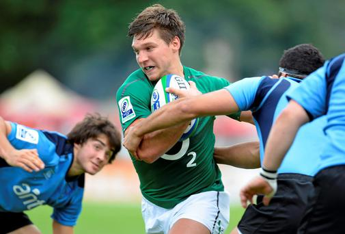 Emerging Ireland's Michael Allen makes a break through the Uruguay defence during the IRB Nations Cup game in Bucharest. Photo: Alex Nicodim / SPORTSFILE