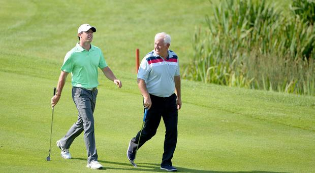 Rory McIlroy in relaxed mood yesterday playing with his father Gerry during the pro-am event prior to this week's Irish Open at Fota Island. Photo: Ross Kinnaird/Getty Images