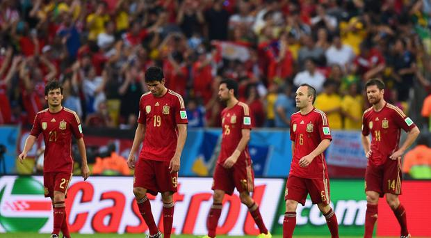 Spain's Diego Costa, Sergio Busquets, Andres Iniesta and Xabi Alonso show their disappointment after Chile's second goal in their World Cup Group B clash at the Maracana last night. Photo: Matthias Hangst/Getty Images