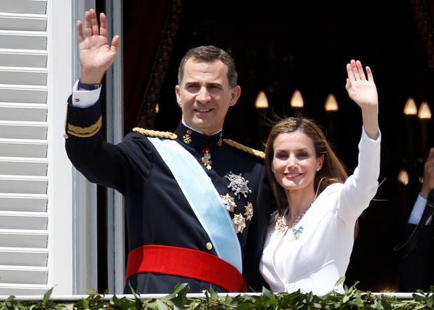 Spain's new King Felipe VI and his wife Queen Letizia appear on the balcony of the Royal Palace in Madrid