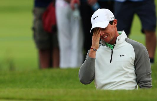 Rory McIlroy reacts after a bunker shot on the 11th during Day One of the 2014 Irish Open at Fota Island Resort, County Cork