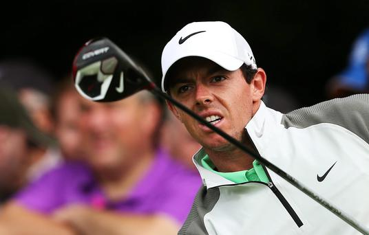 Rory McIlroy watches his drive on the 14th tee during Day One of the 2014 Irish Open at Fota Island Resort