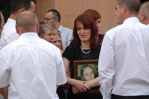 Denise, mother of the late Caitlin Taylor, holding her portrait following her funeral at the Church of the Resurrection, Mallow. Pic: Provision