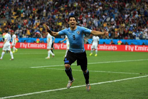 Uruguay's Luis Suarez celebrates scoring the opening goal during the Group D match the Estadio do Sao Paulo