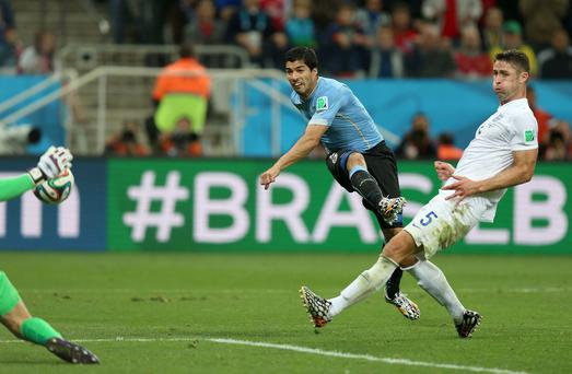 Uruguay's Luis Suarez scores his second goal against England in Sao Paulo