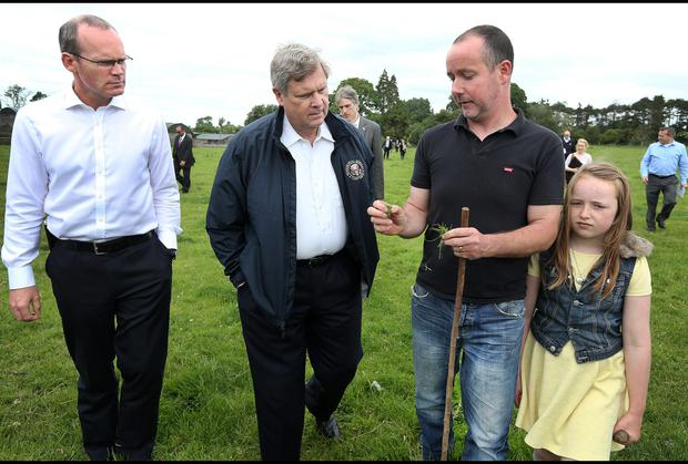 U.S. Secretary of Agriculture Tom Vilsack is shown around a farm in Kill Co Kildare yesterday by Stephen Morrisson (black t shirt) and his daughter Iona (9) alongside Minister for Agriculture , Marine and Food Simon Coveney and a huge entourage of U.S. embassy staff and secret service along with Gardai.