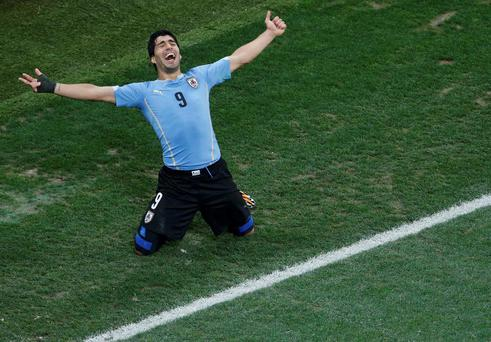 Uruguay's Luis Suarez celebrates scoring his team's second goal against England