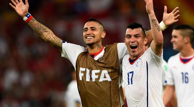 Chile's Arturo Vidal (left) and Gary Medel celebrate after Wednesday's victory over Spain at the at the Maracana. Photo: REUTERS/Dylan Martinez
