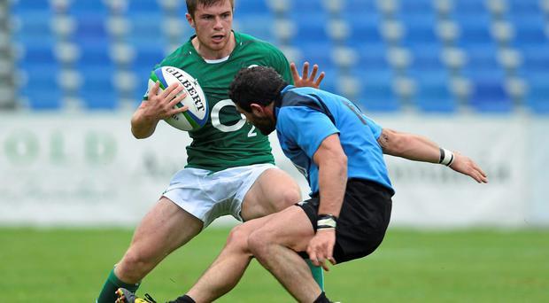 Luke McGrath, Emerging Ireland, is tackled by Agustin Alonso, Uruguay.
