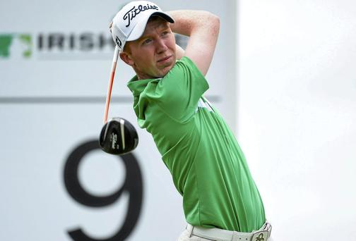 Gavin Moynihan drives off the ninth tee on his way to a 69. Photo: Matt Browne / SPORTSFILE