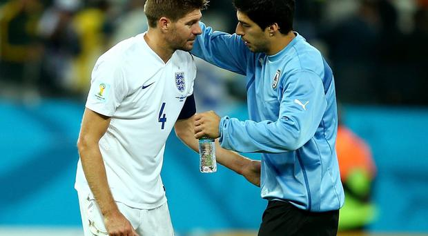 Luis Suarez consoles his Liverpool teammate Steven Gerrard after the final whistle of Uruguay's 2-1 win over England in Sao Paulo. Photo: Clive Rose/Getty Images