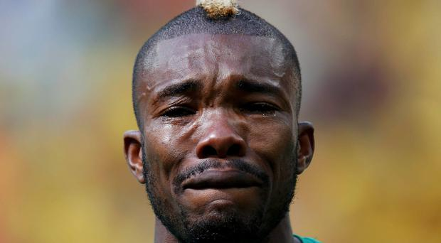 Ivory Coast's Geoffroy Serey Die cries during the playing of his national anthem before the World Cup match against Colombia