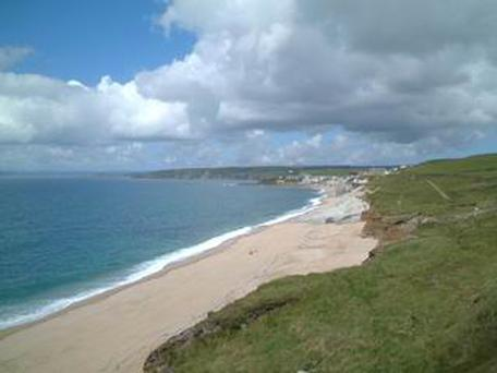 Harry Jack Swordy, 27, and three friends stripped off and ran towards the waves at Loe Bar Beach, near Porthleven in Cornwall, in the first hours of 2014