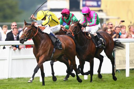 Jockey Ryan Moore riding Rizeena (L) wins the Coronation Stakes during day four of Royal Ascot