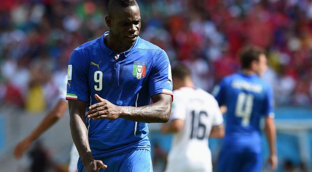 Mario Balotelli of Italy reacts during the 2014 FIFA World Cup Brazil Group D match between Italy and Costa Rica