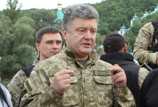 Ukraine's President Petro Poroshenko (C) talks to local residents in the town of Svyatogorsk