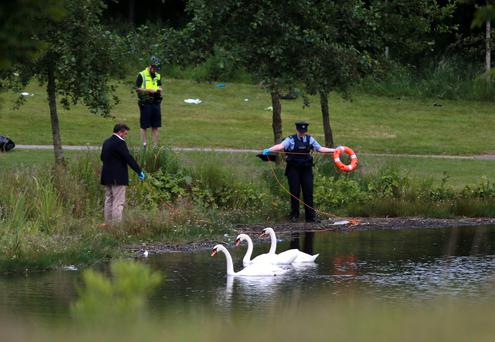 Gardai investigate an incident where three teenagers got into difficulty at a lake in Waterville estate in Blanchardstown. Picture: Arthur Carron