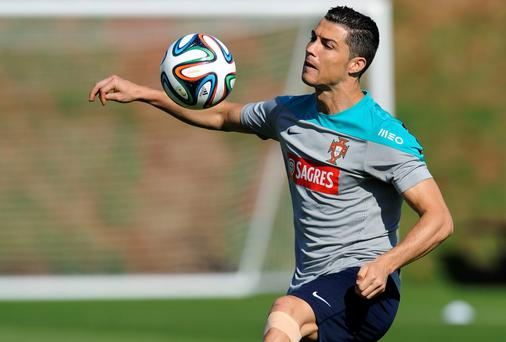 Officials in the Portugal camp have denied reports that Cristiano Ronaldo was abvised to quit the World Cup on the advice of his personal doctor. Photo: AP Photo/Paulo Duarte