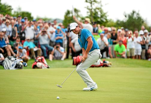 Rory McIlroy reacts after missing a birdie putt on the 14th green during day two of the Irish Open at Fota Island. Photo: Matt Browne / SPORTSFILE