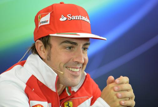 Ferrari driver Fernando Alonso of Spain smiles during a press conference in Spielberg. The Austria Formula One Grand Prix will be held on Sunday. Photo credit: AP Photo/Kerstin Joensson
