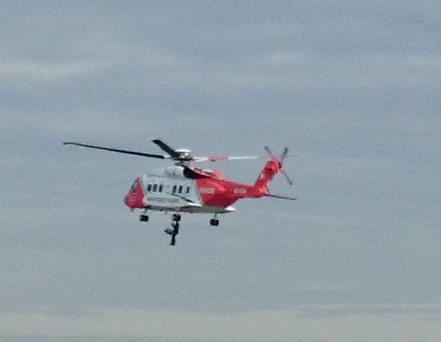 Irish Coast Guard helicopter comes to assistance of woman on beach in Rush, North County Dublin, at approximately 6.45am this morning. This image shows the woman being winched ot safety during the rescue operation Pic: Irish Independent