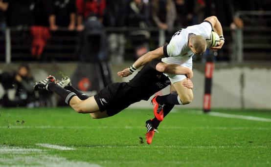 Englands Mike Brown, right, is tackled by New Zealands Ben Smith in the third international rugby test match at Waikato Stadium in Hamilton, New Zealand, Saturday, June 21, 2014.