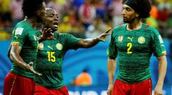Cameroon's Achille Weboc (C) tries to separate teammates Benjamin Moukandjo (L) and Benoit Assou-Ekotto as they argue during their 2014 World Cup Group A soccer match against Croatia