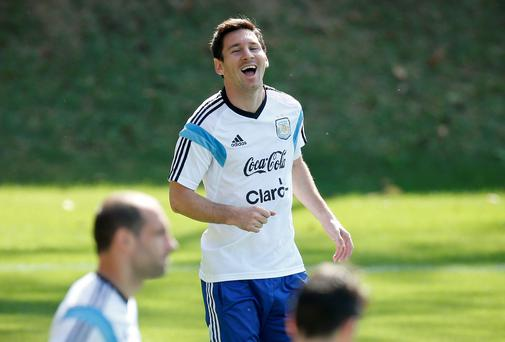 Argentina's Lionel Messi laughs during a training session in Vespasiano, near Belo Horizonte, Brazil