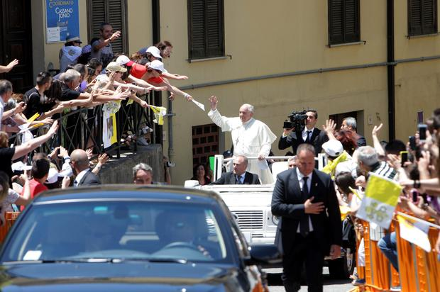 COSENZA, ITALY - JUNE 21: Pope Francis waves to the faithful as he arrives at the Cassano's Seminary on June 21, 2014 in Cassano allo Jonio Cosenza, Italy. Pope Francis is visiting the mafia heartland of Calabria for the first time on Saturday to spend a day in the hometown of a toddler who was murdered in a clan drug war. (Photo by Franco Origlia/Getty Images)