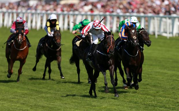 Slade Power ridden by W.M.Lordan on their way to victory in the Diamond Jubilee Stakes during Day Five of the 2014 Royal Ascot Meeting