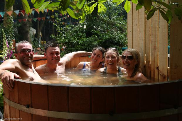 Dave Conway and Suzanne Beardsley with friends in the hot tub at Body & Soul