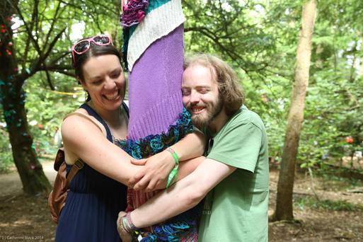 Emma Byrne from Wexford and Mark Dixon from Dublin hugging a tree at Body & Soul Festival