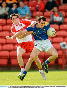 Paul Barden, Longford, in action against Gareth McKinless
