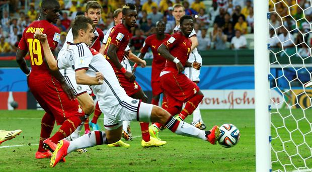 Germany's Miroslav Klose (front) taps the ball in to score against Ghana during their 2014 World Cup Group G soccer match at the Castelao arena in Fortaleza June 21, 2014
