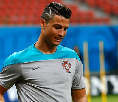 Ronaldo has never been afraid of rocking some perfectly coiffed barnets, but this one looks as if his barber dropped the clippers mid-shave.