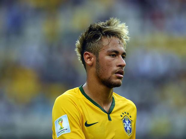 Neymar Jr: The most famous man in Brazil's hair is all over the place. Up at the front, shaved at the sides, terrible blond highlights... a mess.