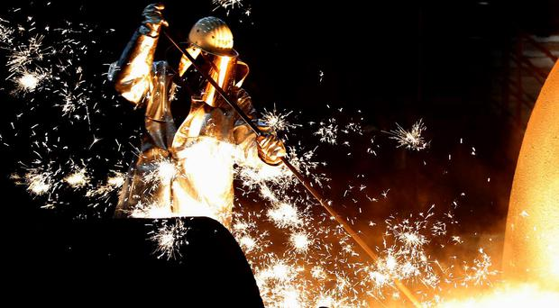 A worker at a blast furnace at Europe's largest steel factory of Germany's industrial conglomerate ThyssenKrupp AG
