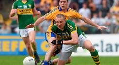 Kerry's Kieran Donaghy battles with Shane McNeils of Clare during their Munster SFC semi-final. Photo: Ray McManus / SPORTSFILE