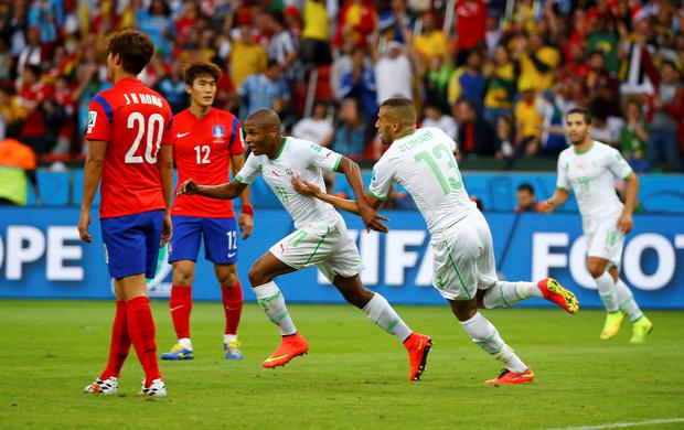 Algeria's Yacine Brahimi celebrates with Islam Slimani after scoring a goal during the 2014 World Cup Group H soccer match between South Korea and Algeria at the Beira Rio stadium in Porto Alegre June 22, 2014